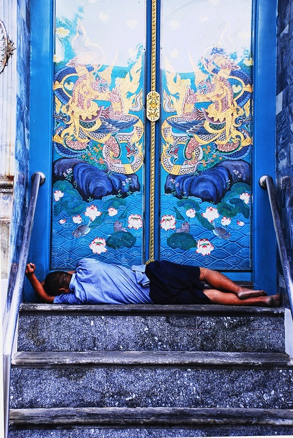 Waiting at the Heaven's Door - by Diego Rios    This is a dramatic image that I captured during my visit to Bangkok, Thailand while I was walking around one of the main temples in the city. A guy laid down out of the temple's door waiting for the temple's door being opened.