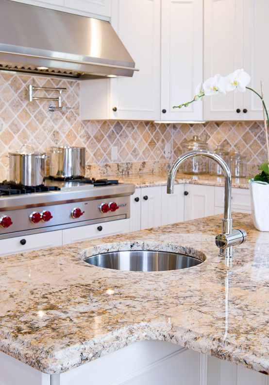 Sienna Bordeaux Granite for a Traditional Kitchen with a Ogee Edge and Solarius Granite Countertops by Counteredge
