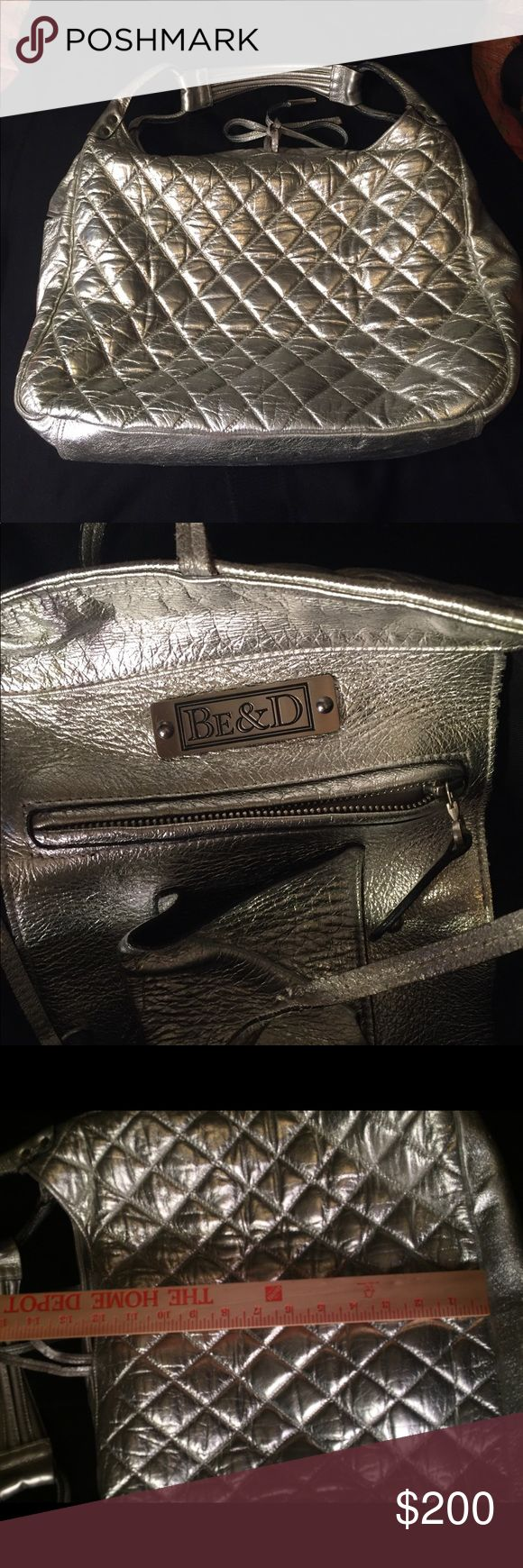 Be&D leather silver shoulder bag in grt condition! This bag is in very good condition.  Some spots on bottom(see pic), Ties closed.  Inside has zipper pocket, cell phone pocket, and another large pocket.  For measurements, see pics. Be & D Bags Shoulder Bags
