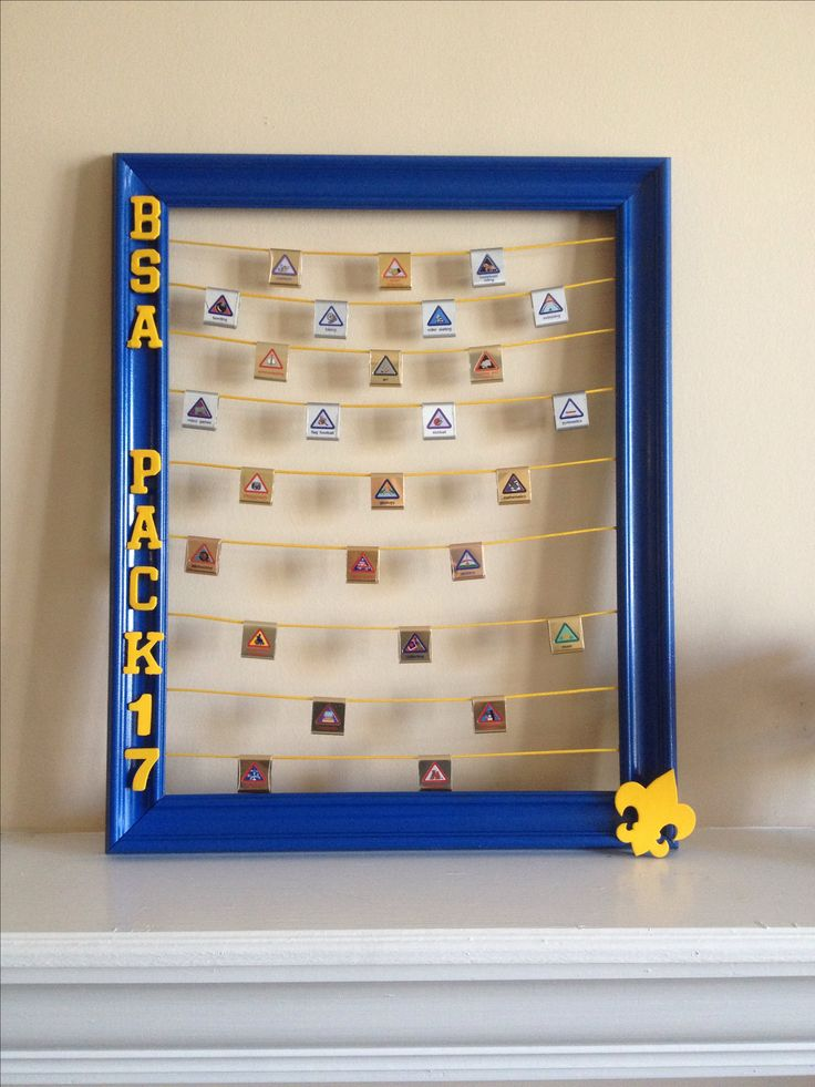 Take an old 16x20 frame add some paint and embellishments to create a custom belt loop display! #cubscouts #boyscoutsofamerica #beltloops