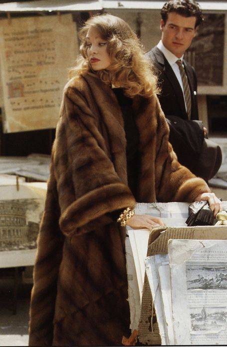 mink fur coat - love these sleeves, the wearer really carries this off, and the man watching agrees.