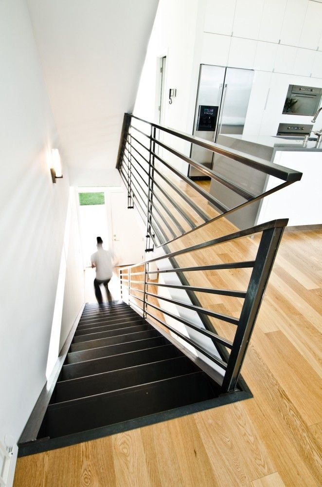 Creative solution for a stair rail in the same plane. Pb Elemental Architecture