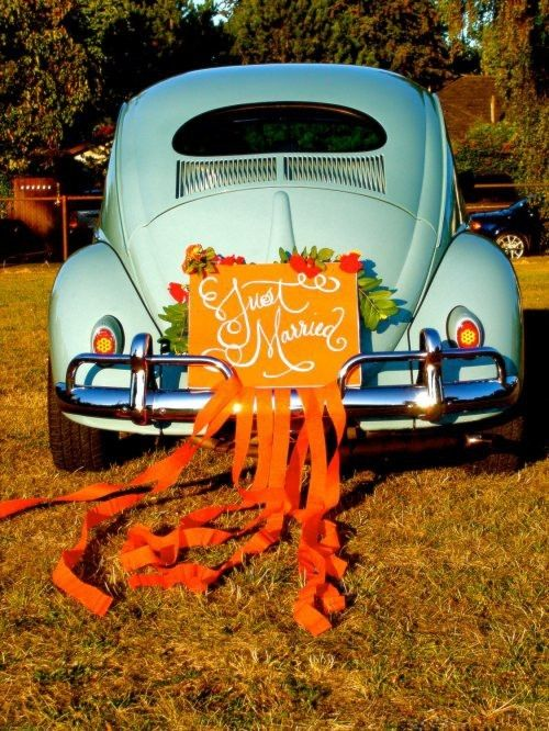 Vintage getaway car 'Just Married' love the streamers and the cute font