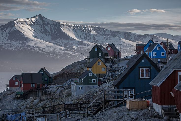 Greenland | Lawrence Hislop Photography. Landscape photograph of colored houses and mountain in Greenland.