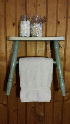 Repurposed chair to towel rack with shelf.