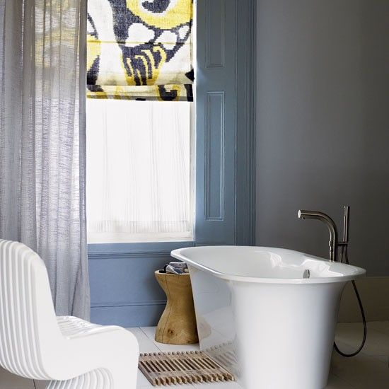 Softened light with linen curtain; dash of colour with panelling and good shaped bath tap!