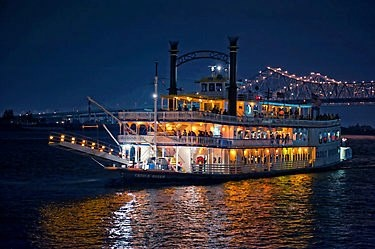 A paddlewheel river boat on the Mississippi River in New Orleans . . .by Louisiana Travel Promotion Association