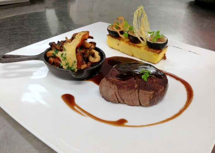 Seared filet mignon with Pinot sauce, Cassoulette of Chanterelle and Lobster mushrooms, Polenta cake with Port wine roasted figs