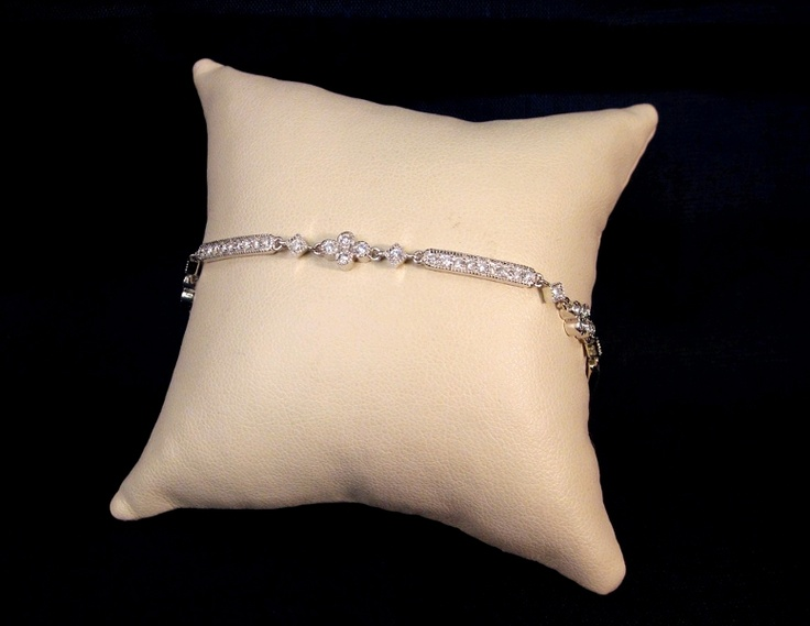 18k white gold diamond bracelet. Bead-set in a floral, dainty style.