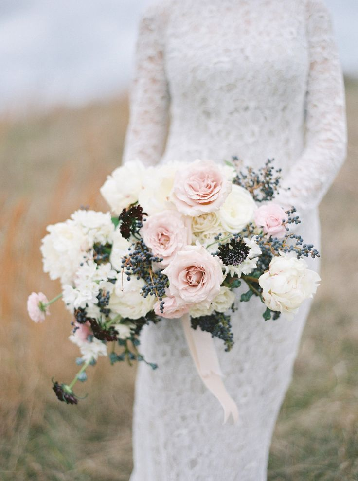 Hydrangea, peony, rose and scabiosa wedding bouquet: Photography : Amelia Johnson Photography Read More on SMP: http://www.stylemepretty.com/little-black-book-blog/2016/11/14/elegant-winter-wedding-inspiration-winery/