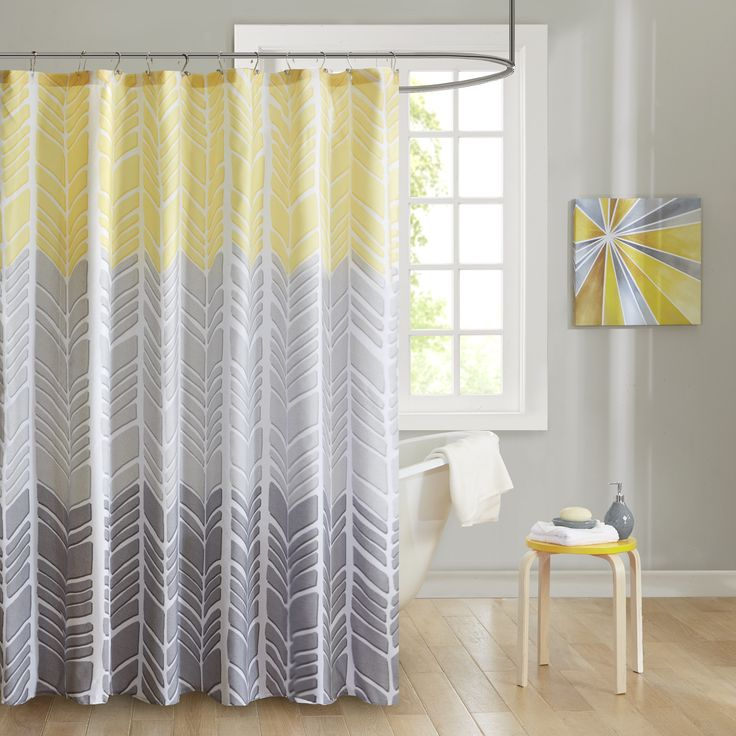 Create a colorblocked look in your bathroom with the Kennedy Collection. This geometric chevron design uses light grey, taupey grey and yellow/ aqua for a unique update to this pattern.