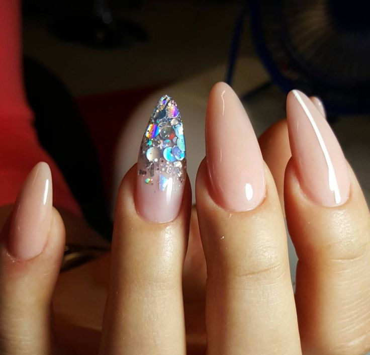 Nude almond nails with glitter accent nail