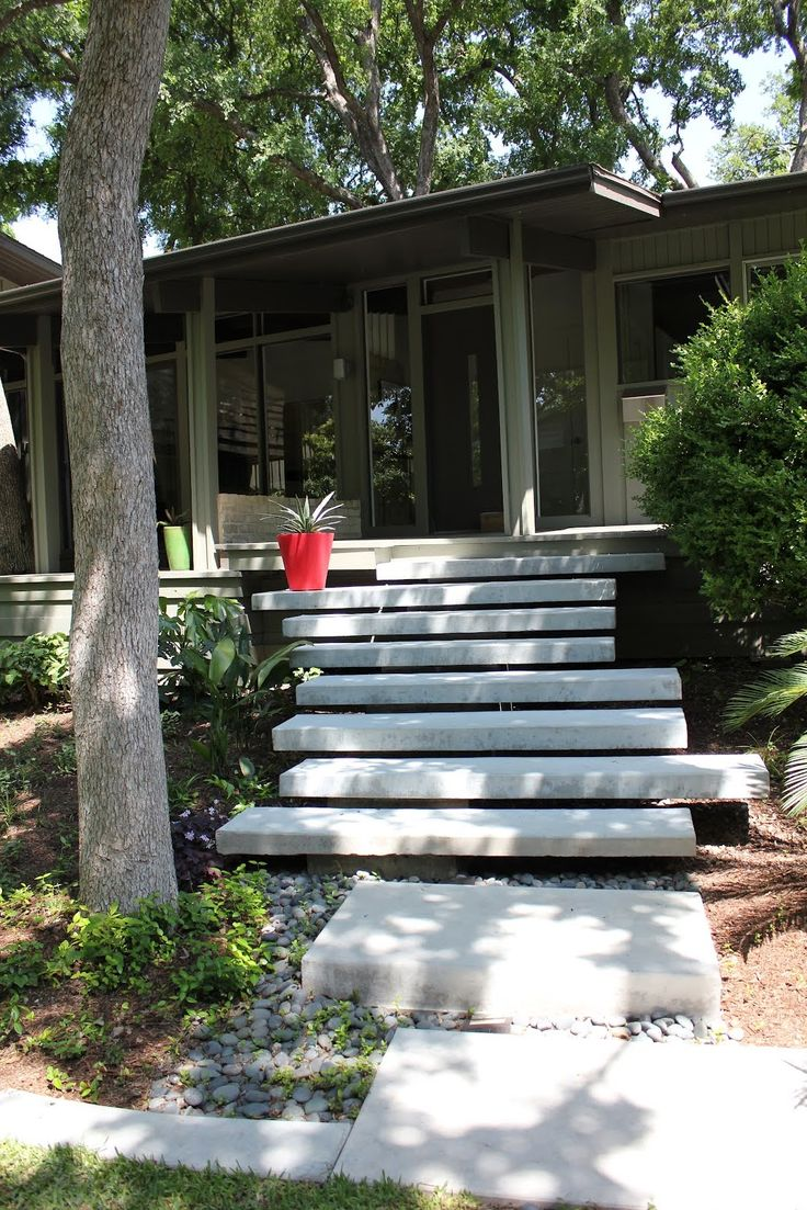 Concrete floating stairs, 1965 Mid-Century Modern home in the Lakewood area of Dallas, landscaping/hardscaping by one speciality.