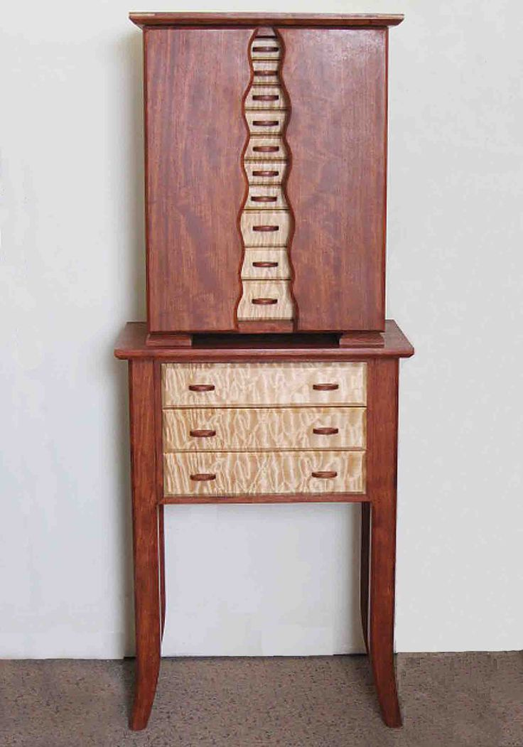 This beautiful armoire jewelry box is handmade of exotic woods and is designed to hold every type of jewelry imaginable!