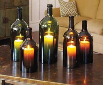 Cut the bottoms off wine bottles to use for candle covers, keeps the wind from blowing them out when outside @ Home Decor Ideas