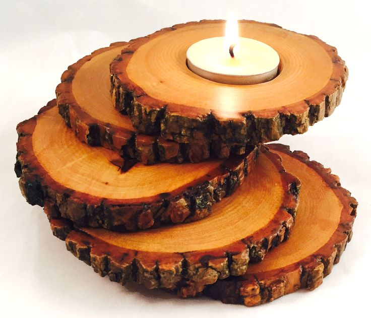 Beautiful #rustic wood slices spiral up to create a one of a kind candle holder.  Use promo code SAVE10 for 10% off now: http://www.manmadewoods.com/product/spiral-wood-candle-holder/