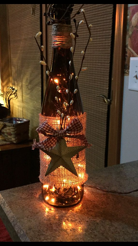These are colored wine bottles. The have a drilled hole in back bottom of bottle with a string of mini lights . They have either a rusty star or a light colored star. Chose either checked blue or red accent bow when ordering. They will have the white pip-berry sprig or maroon. Please allow a few days as I make each one as ordered. I also have 1 painted sunflower green bottle.