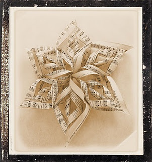 I have made these with wrapping paper but I love it with sheet music.  Vintage Christmas music would be wonderful