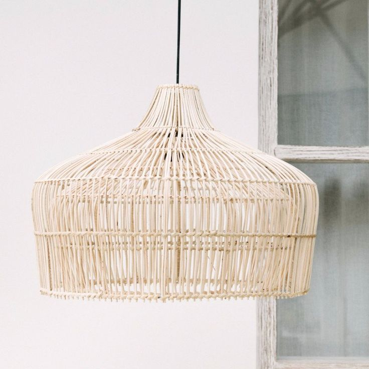 Double Belly Pendant. A favourite with White Moss, we love this stunning, unique design with the 'double belly' effect and the delicate lattice, hand woven by Balinese artisans in lightly bleached natural rattan. Make a statement in any room with this elegant pendant light shade.