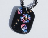 Polymer clay pendant from millefiori cane, on a viking knit chain.