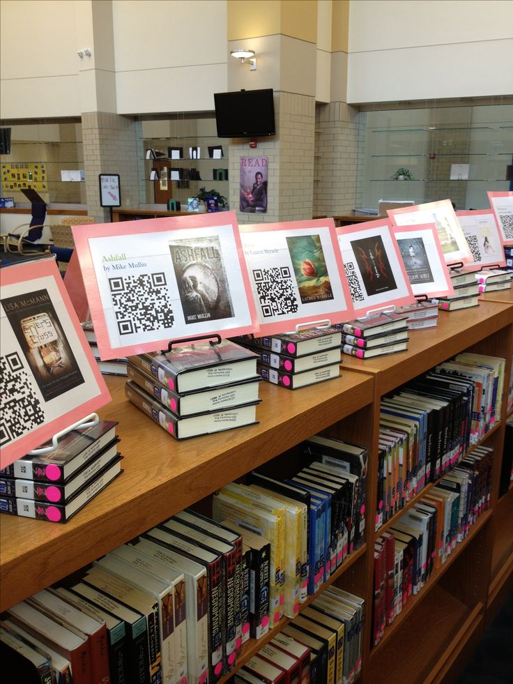 Students watch book trailers linked with QR codes. Whoa, great idea. Have students make their own trailers for MG novels? (Image only)
