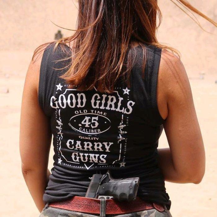 Customer Photo: Good Girls. Carry Guns. Women's T-Shirt.