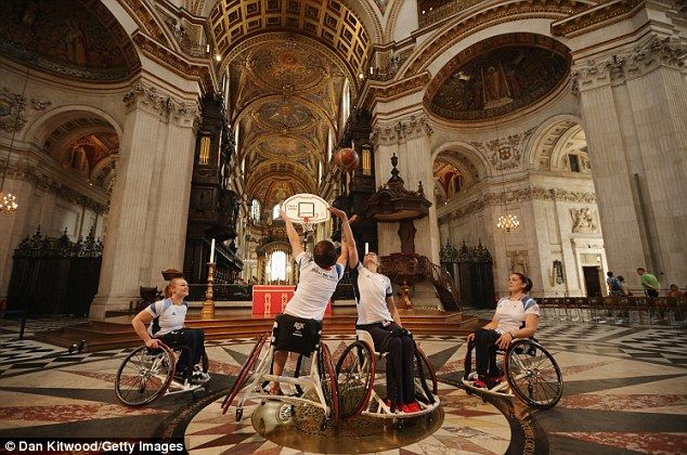 Let the Games begin (again): Wheelchair basketball team practice inside St Paul's cathedral as torch arrives in London for start of Paralympics