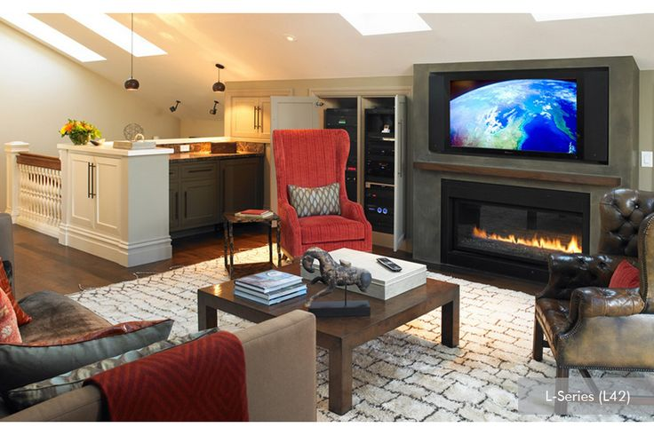 Great design showing a tv above your linear fireplace.  Perfect application for a basement.
