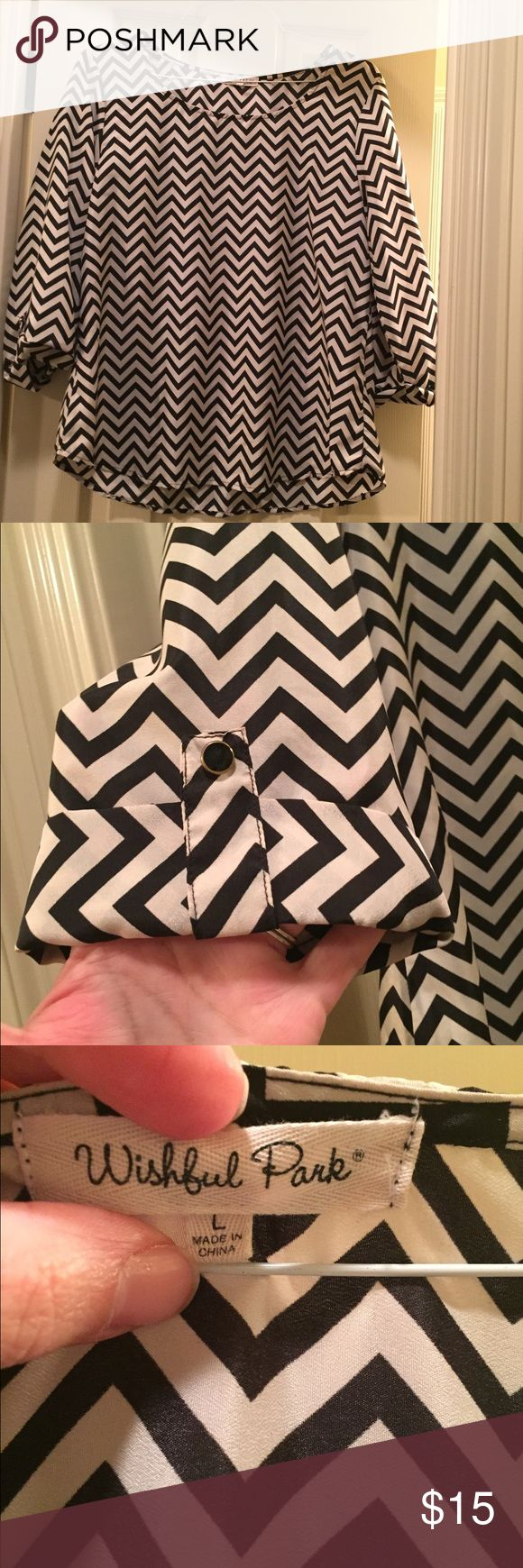 Cute chevron top Excellent used condition. Worn handful of times. Black and ivory. wishful park Tops Blouses