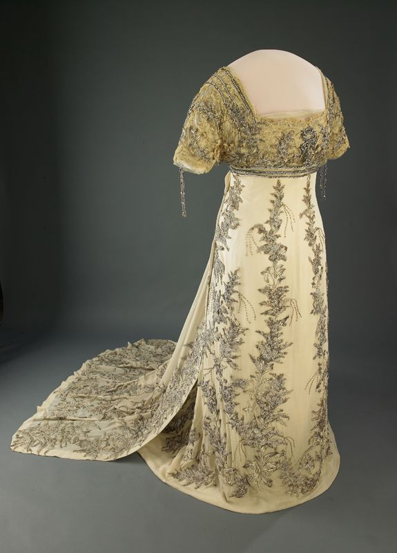 Helen Taft's Inaugural Gown. Helen Taft's 1909 inaugural ball gown is made of white silk chiffon appliquéd with floral embroideries in metallic thread and trimmed with rhinestones and beads. It was made by the Frances Smith Company. The fabric and embroidery have become discolored, and most parts of the skirt were replaced as part of a 1940s conservation effort.