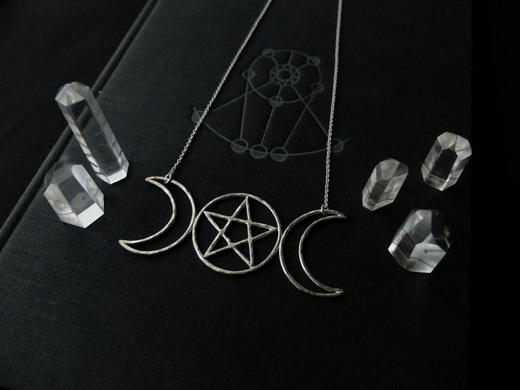 under the pyramids Esbat II  Totem  https://www.etsy.com/listing/509836435/esbat-ii-triple-moon-totem-with-pentacle