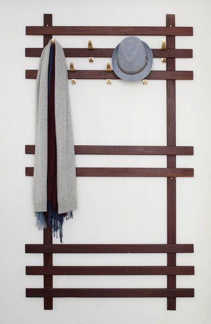 Instead of a coat rack.. Maybe try this with empty wall space