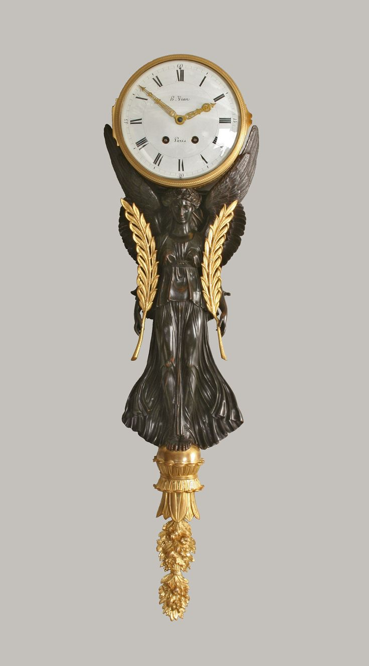 An Empire Gilt and Patinated Bronze Nike Figure Wall Clock