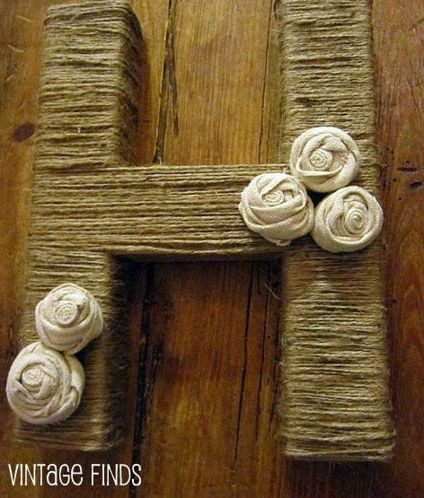 Another cute idea! Twine wrapped letter~ instructions here for making fabric flowers as well-
