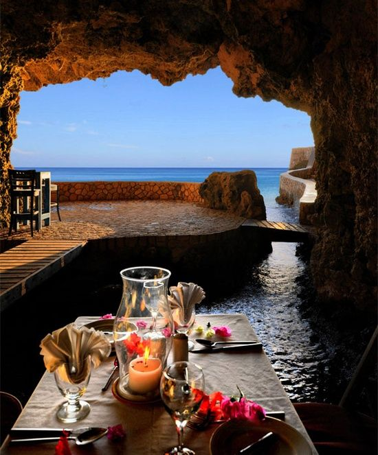 Cave restaurant, Negril, Jamaica. Negril is a small (population 3,000) but widely dispersed beach resort town located across parts of two Jamaican parishes, Westmoreland and Hanover.