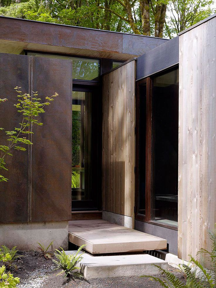 Minimalist House // A balance of clean lines and natural materials for this modern entry. mw|works architecture+design designed the Case Inlet Retreat for a family in Washington State.