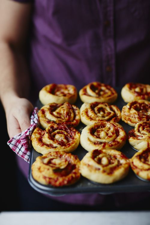 stromboli buns containing prosciutto, cheddar cheese, chillies and tomatoes - pizza rolls