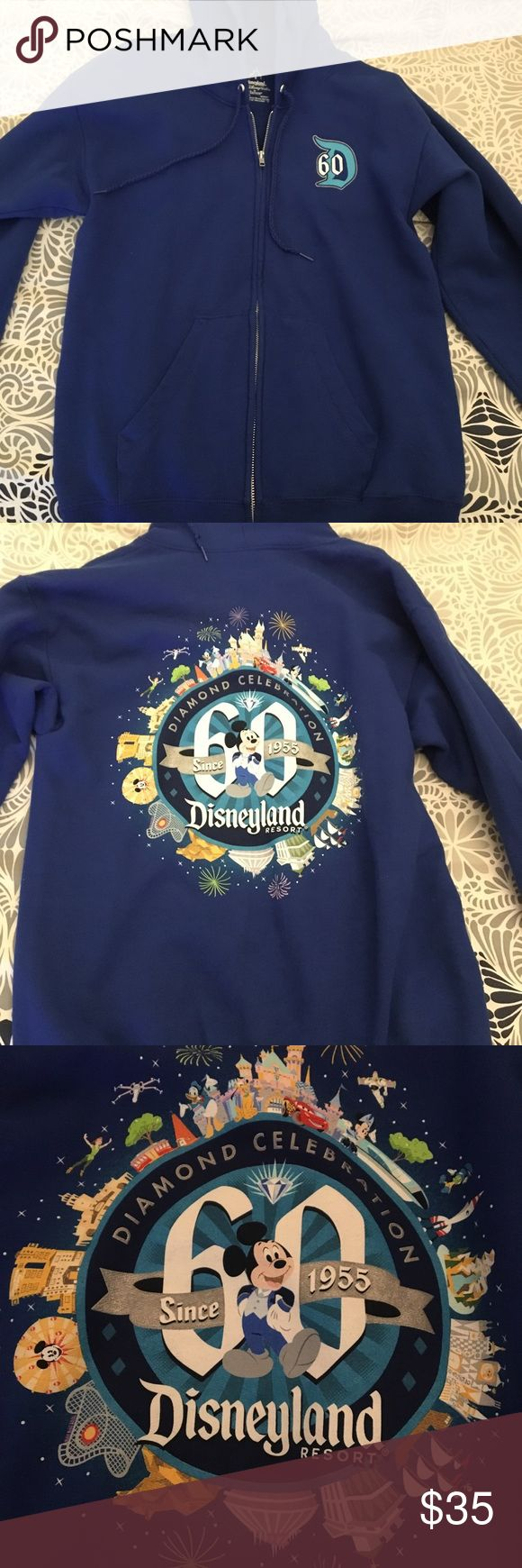 Disneyland's 60th Anniversary Hoodie Disney's Diamond Celebration hoodie, for their 60th anniversary! This hoodie is a gorgeous blue, thick, and is great for keeping yourself warm! There's a beautiful print on the back of some of the most prominent rides/features and a cute little D 60 in front. No flaws! Was just too loose for me, so I barely reached for it, so it's just about in perfect condition! Disney Tops Sweatshirts & Hoodies