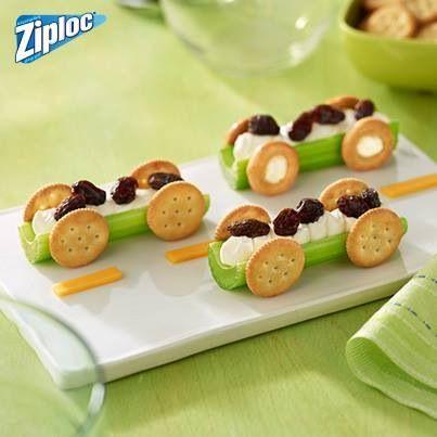 Food art > Celery Race Cars with Cream Cheese & Raisins & Mini Crackers for the Wheels.
