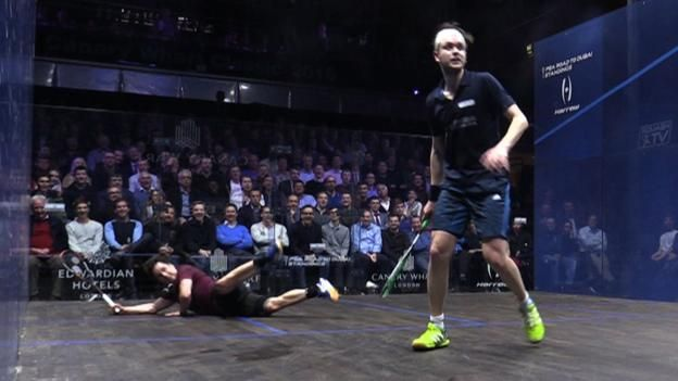 New Zealand squash player Paul Coll does the splits, and makes two full-stretch dives, to win a point against England's former world number one James Willstrop at the PSA World Tour Canary Wharf Classic in London.