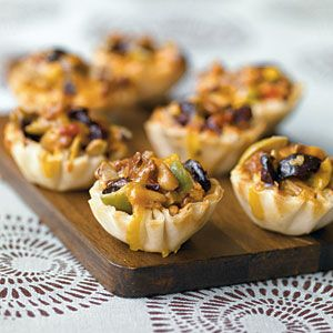 Greek Olive Cups: get the pre-made phyllo dough shells, stuff with chopped olives, pecans, pine nuts and cheese; bake @375 degrees for 12-15 mins. Yum!