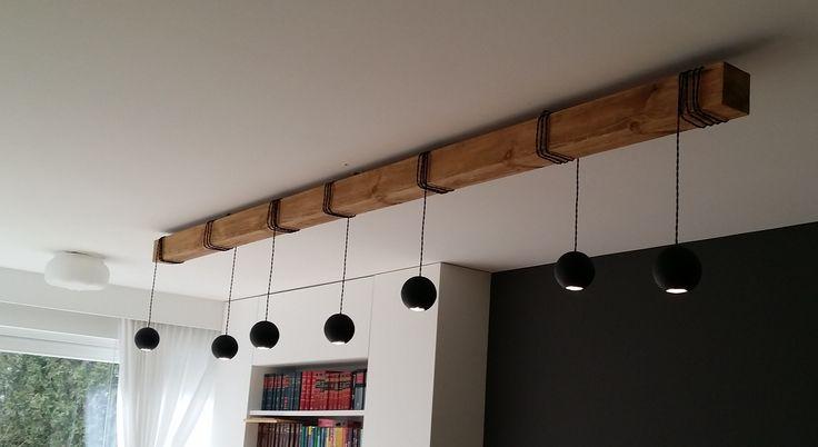 Lampa Bella;  projekt Jacek Tryc - wnętrzahttp://tryc.pl, realizacja Cubeo.  Lampa na sosnowej belce, może mieć różne kolory i wisieć na dowolnym rodzaju drewna, Dostosujemy ją do Twoich pragnień! Lamp Lamp Bella; project: @Jacek Tryc-wnętrza       http://tryc.pl,realization: @cubeo1601 - meble  #lamp #wood #interior #designe #light