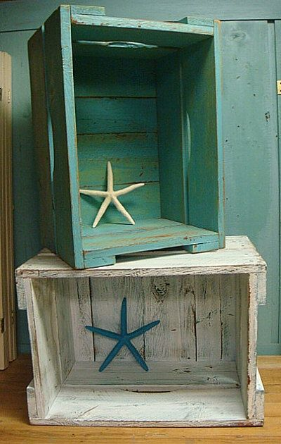 Wooden crates for toys painted blue and natural wood. Can fit under the board and around the edges of the room