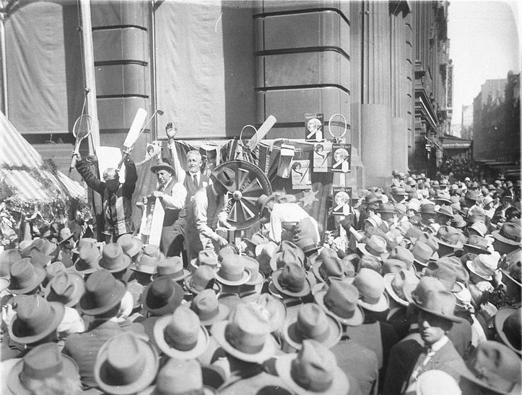 https://flic.kr/p/agkFxX | Chocolate wheel, United Charities Fund Street Fair, Pitt Street, Sydney, 1920s, by Sam Hood | Format: Photograph  Find more detailed information about this photograph: acms.sl.nsw.gov.au/item/itemDetailPaged.aspx?itemID=7552  Search for more great images in the State Library's collections: acms.sl.nsw.gov.au/search/SimpleSearch.aspx  From the collection of the State Library of New South Wales www.sl.nsw.gov.au
