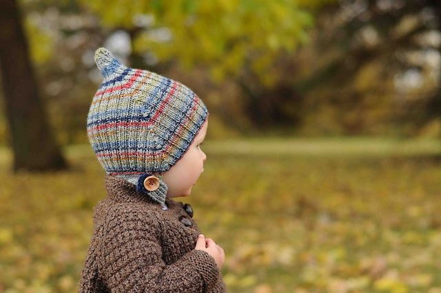 This pattern can be made with one 50 gram ball of fingerling weight wool. It's much cuter if the hat is a little big (its a little small as shown on my son, but I've adjusted the pattern so that it should fit a 12 month old). Unlike the other pixie hats I've seen in 2x2 ribbing, this one is worked in the round, so it will create its own circular stripes if done with a striping yarn. I hope you enjoy this quick knit.