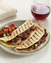 Grilled Lamb and Red Onion Tacos with Tomato-Mint Salsa // More Amazing Tacos: http://fandw.me/Wf7 #foodandwine