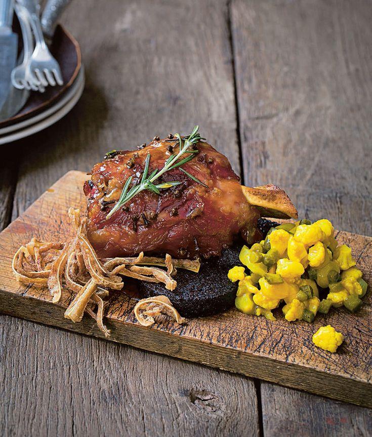 Honey-roast ham hock with crisp pig's ears, black pudding and piccalilli