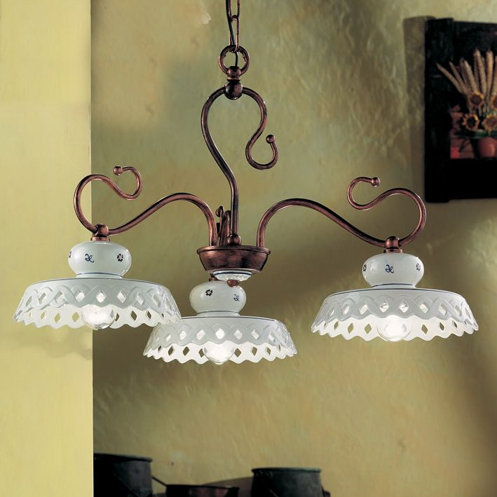 Refined suspension with brass structure and hand decorated ceramic shades.
