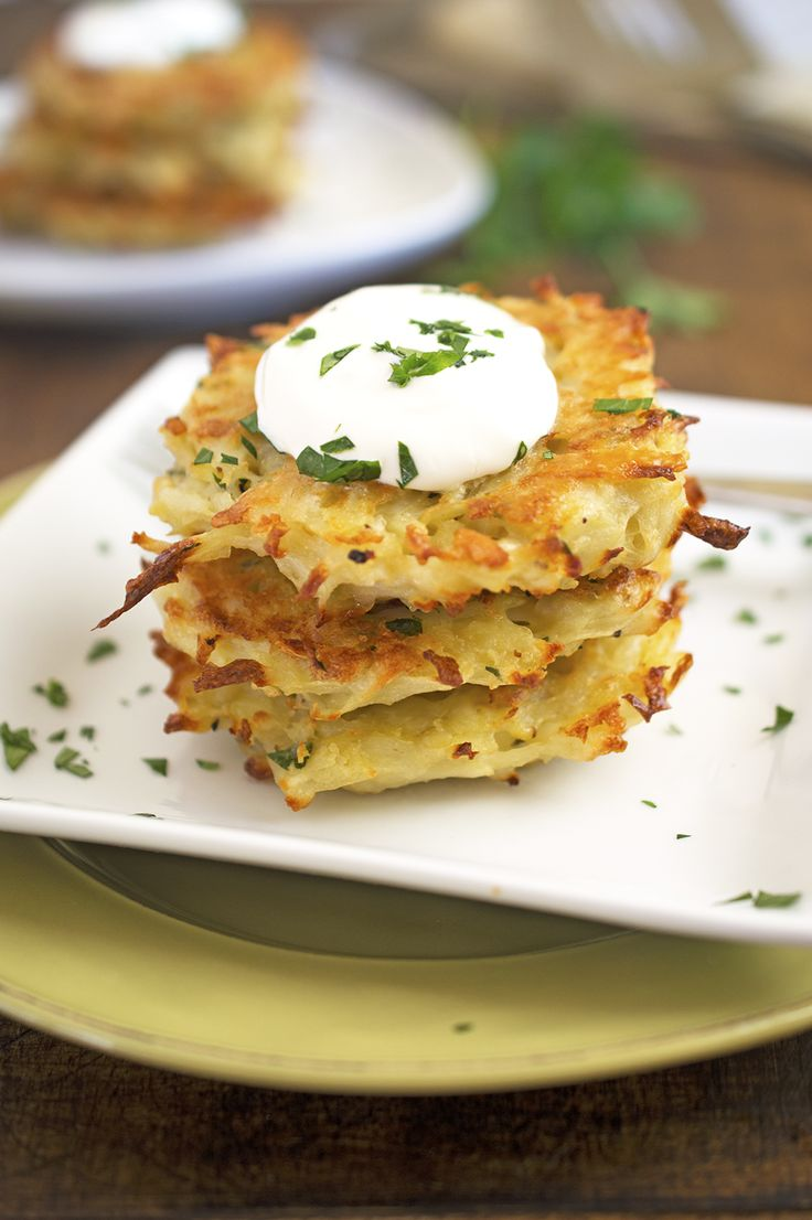 Baked Potato Pancakes served with sour cream and chopped fresh parsley. Healthier alternative to the traditional Potato Latkes. Recipe by chefsavvy.com