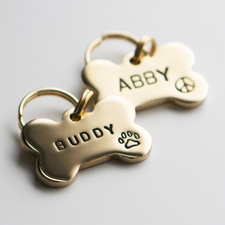 Dog Tag / Pet ID Tag, Bone Shaped Tag -Brass-, Customized, Personalized, Hand Stamped by wagtagdesign on Etsy https://www.etsy.com/listing/222796576/dog-tag-pet-id-tag-bone-shaped-tag-brass
